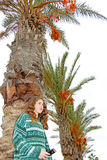 Teen girl and palm trees Royalty Free Stock Photos