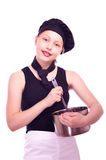 Teen girl with pan and ladle Royalty Free Stock Image