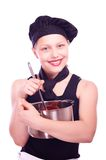 Teen girl with pan and ladle Stock Photos