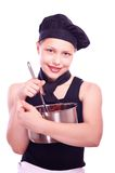Teen girl with pan and ladle Royalty Free Stock Photography