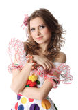 Teen girl in party dress. A portrait view of a pretty teenage girl looking somewhat coy in a bright, colorful party dress Royalty Free Stock Photo