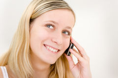 Teen girl on phone Royalty Free Stock Image