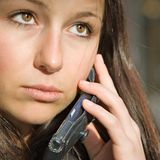 Teen girl on phone. Young beautiful brunette female on cell phone stock photos