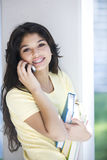 Teen girl on the phone. Happy teen girl on the phone Royalty Free Stock Image