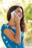 Teen girl with a phone in  park Royalty Free Stock Photography