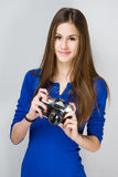 Teen girl with a photo camera. Royalty Free Stock Photo