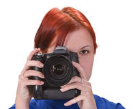 Teen girl photographer. Portrait of a redheaded girl taking photos with a DSRL camera.Shot with Canon 70-200mm f/2.8L IS USM Royalty Free Stock Image