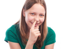 Teen girl picking her nose Stock Photos
