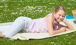 Teen girl at picnic Stock Images