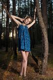 Teen girl in a pine forest Stock Photo