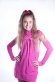 Teen girl in a pink dress posing Royalty Free Stock Photos