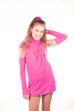 Teen girl in a pink dress posing Stock Image