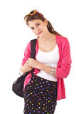 Teen girl with pink sweater and backpack Royalty Free Stock Photos