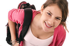Teen girl with pink sweater and backpack Royalty Free Stock Images
