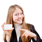 Teen girl with plastic card. Attractive girl is showing plastic card and is smiling on white background Stock Image
