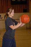 Teen Girl playing Basketball. Pretty Teen Girl with Basketball in Gym Royalty Free Stock Photo