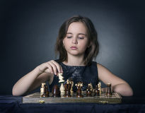 Teen girl playing chess Stock Photography