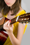 Teen girl playing guitar Stock Photo