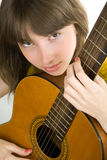 Teen girl playing guitar Stock Photography