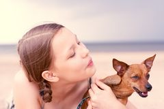 Teen girl playing with her dog Stock Photos