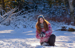 Teen girl playing in snow Stock Photos