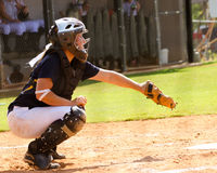 Teen girl playing softball Royalty Free Stock Image
