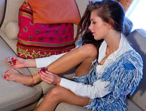 Teen girl polish her toenails Royalty Free Stock Photography