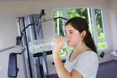 Teen girl with pony tail jogging on treadmill Royalty Free Stock Images