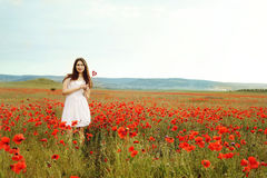 Teen girl in poppy field Royalty Free Stock Photography