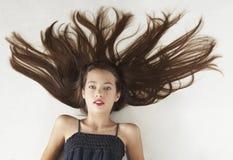 Teen Girl Portrait. Portrait head shot of a teen girl against a white studio background Stock Photos