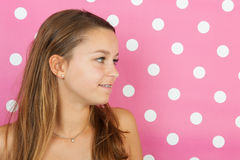 Teen girl portrait on pink Stock Photos