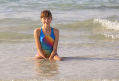 Teen girl posing on the beach in afternoon. Teenager girl  is smiling and posing at the sea side in the afternoon Stock Photo