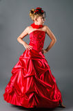 Teen girl posing in prom dress in studio Royalty Free Stock Images