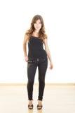 Teen girl posing in tight black pants Stock Photos
