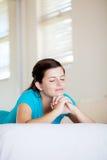 Teen girl praying stock image