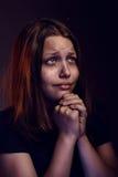 Teen girl praying Stock Photos