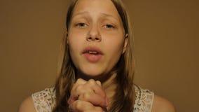 Teen girl praying. 4K UHD stock video footage