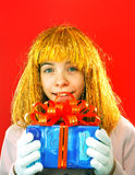 Teen girl with a present Stock Images