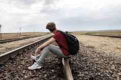 Teen girl with problems sitting on rail road Royalty Free Stock Images