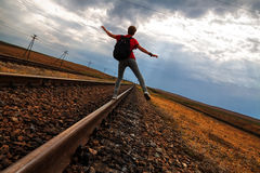 Teen girl with problems walking on rail road Royalty Free Stock Photos