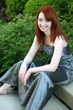 Teen girl in prom dress. Beautiful red haired girl in prom dress Stock Image