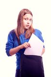 Teen girl puts something in a bag Royalty Free Stock Photography