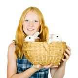 Teen girl with rabbits. Isolated on white background Royalty Free Stock Images