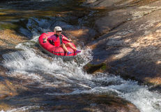 Teen girl rafting. Teen girl alone rafting on the river. Horizontal Composition Stock Photo