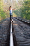 Teen girl on rail Royalty Free Stock Photo