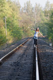 Teen girl on rail Royalty Free Stock Images