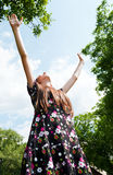 Teen girl with raised hands Royalty Free Stock Photography
