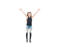 Teen girl raising hands and smiling widely. Adorable brunette teen girl in short shorts and tanktop raising hands and smiling widely Royalty Free Stock Photography