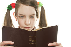Teen girl reading the Bible. Isolated on white Royalty Free Stock Photo