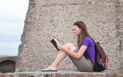 Teen girl reading the Bible Stock Image